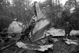 "FILE - This Oct. 20, 1977 file photo shows the wreckage of a plane in a wooded area near McComb, Miss., where six people were killed, including three members of the music group Lynyrd Skynyrd. A New York federal appeals court says a new Lynyrd Skynyrd film, ""Street Survivors: The True Story of the Lynyrd Skynyrd Plane Crash,"" can be released despite a dispute over the band's intentions. A lower court judge decided previously that the film violated a ""blood oath"" made by band members not to exploit the group's name after the crash. (AP Photo, File)"