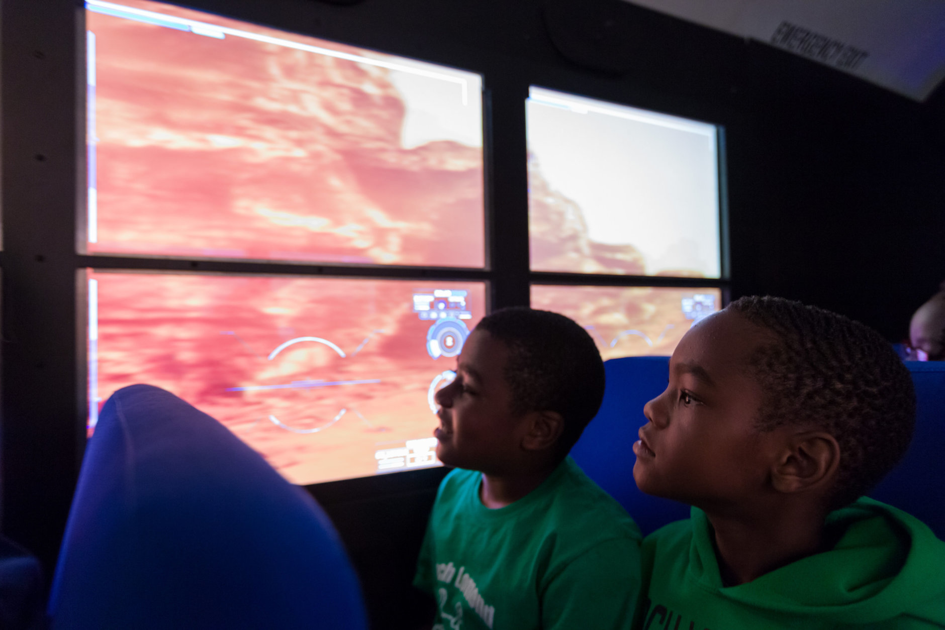 Amos Kear, 9, left, and Nate Wilson, 8, look at the surface of the planet Mars, seated in the Lockheed Martin Mars Experience bus. The boys and their classmates from Virginia's Loch Lomond Elementary School robotics team were the first group of local students to visit the bus at the the Steven F. Udvar-Hazy Center in Chantilly, Virginia, Oct. 19, 2018, following a ceremony in which Lockheed Martin transferred the bus to Smithsonian's Air & Space Museum. The bus, fitted with high-definition monitors on the windows, provides visitors an opportunity to experience the Martian surface. (Air and Space photo by Daniel Soñé)