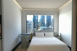 Guest rooms at Motto will average just 163 square feet, but will include space-saving features like wall-beds, loft beds, segmented shower and toilet stalled and multi-functional furniture that can be stowed away when not in use. (Courtesy Hilton)