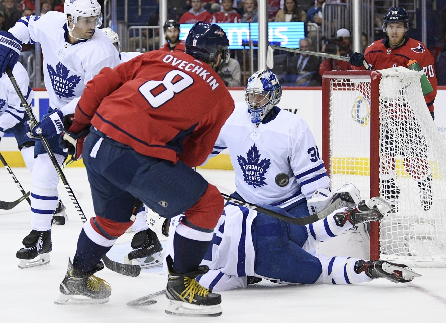 Toronto Maple Leafs goaltender Frederik Andersen (31), of Denmark, stops the puck against Washington Capitals left wing Alex Ovechkin (8), of Russia, during the second period of an NHL hockey game, Saturday, Oct. 13, 2018, in Washington. Also seen is Maple Leafs defenseman Ron Hainsey (2). (AP Photo/Nick Wass)