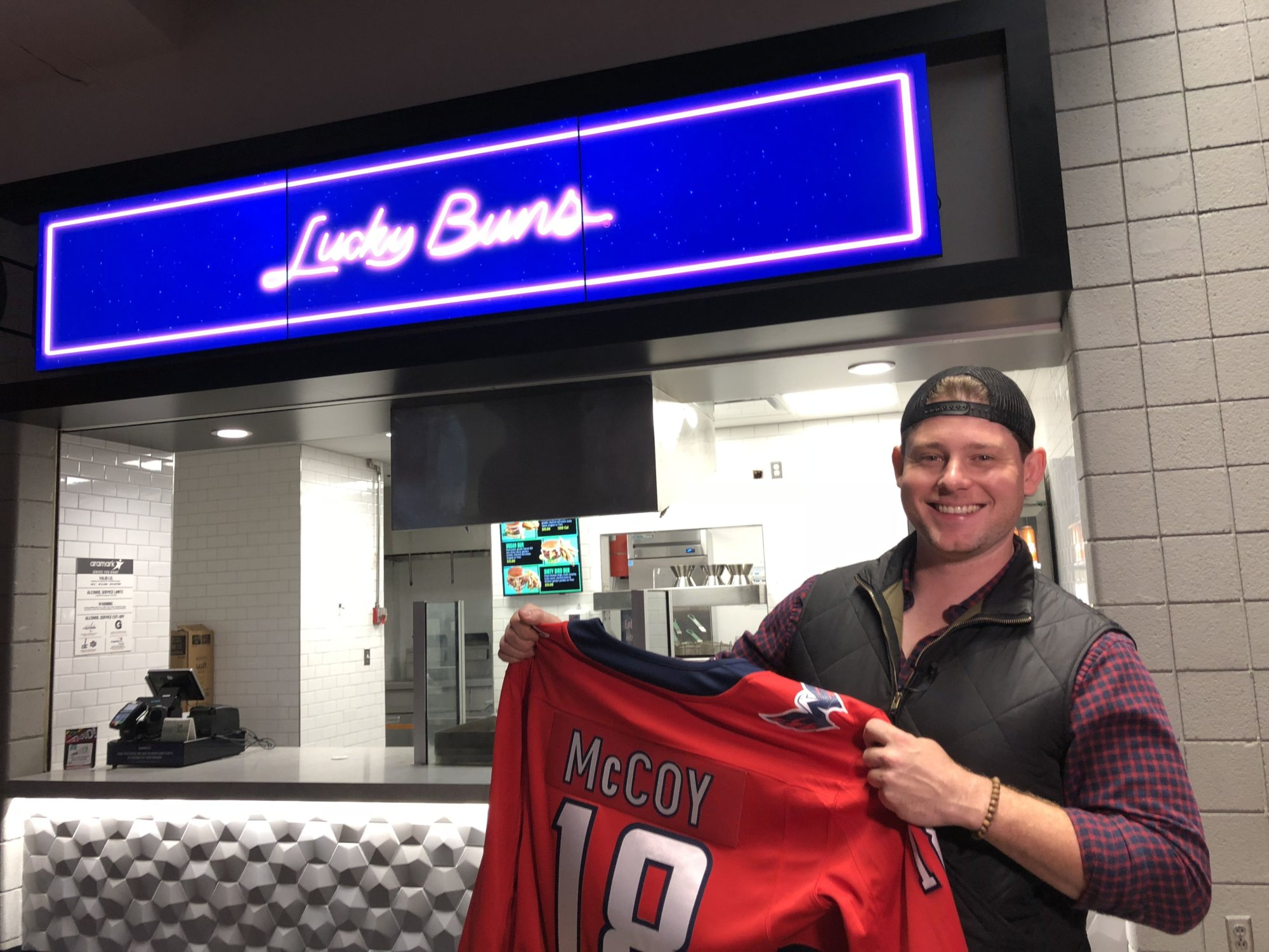 """I've been coming to this arena since I was a little kid,"" local Chef Alex McCoy of Lucky Buns said. The Lucky Buns menu features specialty burgers. ""I can't tell you how much it means to be able to come into this arena to cook for my friends and cook for other D.C. sports fans."" (WTOP/Kristi King)"