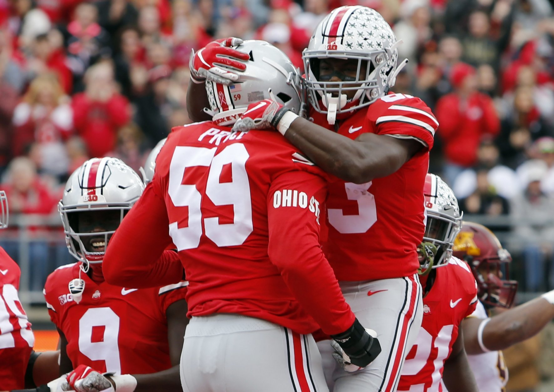 Ohio State receiver Terry McLaurin, right, celebrates his touchdown against Minnesota with teammate Isaiah Prince during the first half of an NCAA college football game Saturday, Oct. 13, 2018, in Columbus, Ohio. (AP Photo/Jay LaPrete)