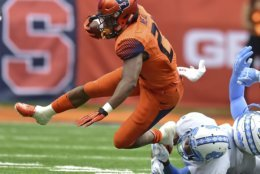Syracuse running back Moe Neal (21) runs against North Carolina during an NCAA college football game, Saturday, Oct. 20, 2018, in Syracuse, N.Y. (Scott Schild/The Post-Standard via AP)