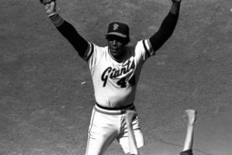 """FILE - In this July 3, 1980, file photo, San Francisco Giants' Willie McCovey raises his hands in salute to the cheering crowd after he was replaced in the lineup in the team's baseball game with the Cincinnati Reds in San Francisco. It was the last home appearance before retirement for the popular veteran.  McCovey, the sweet-swinging Hall of Famer nicknamed """"Stretch"""" for his 6-foot-4 height and those long arms, has died. He was 80.  The San Francisco Giants announced his death, saying the fearsome hitter passed """"peacefully"""" Wednesday afternoon, Oct. 31, 2018, """"after losing his battle with ongoing health issues."""" (AP Photo/Robert Houston, File)"""