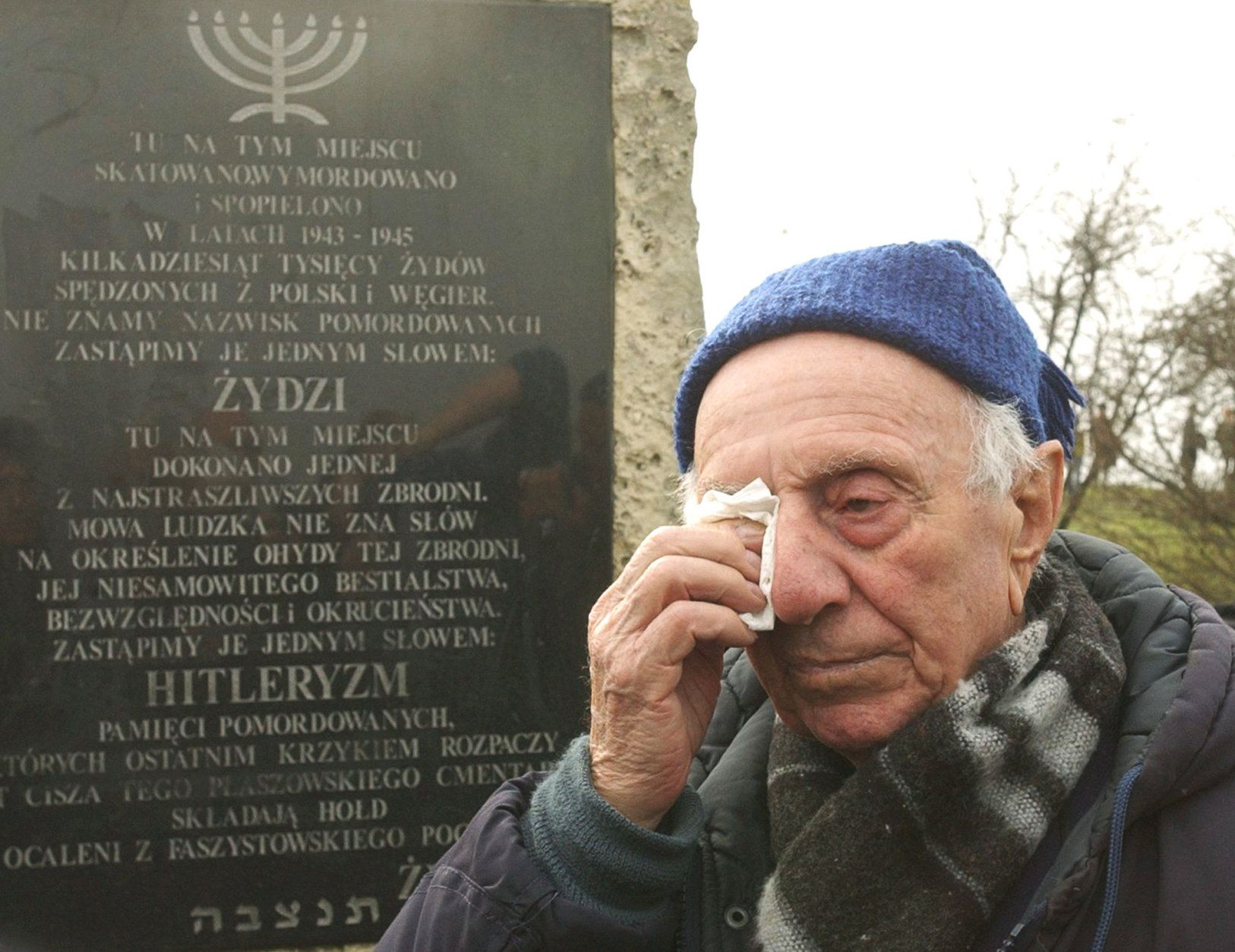 Ludwik Kuczer, 87, one of the Jews saved by German industrialist Oskar Schindler, wipes a tear during a ceremony at a monument in the former Nazi camp in Plaszow, district of  Krakow, southern Poland, Sunday, March 16, 2008, to mark the 65th anniversary of the liquidation of the Krakow Ghetto. In just two days in March 1943, German soldiers emptied the ghetto of its estimated 16,000 Jewish residents, shipping them to forced labor and death camps. (AP Photo/Alik Keplicz)