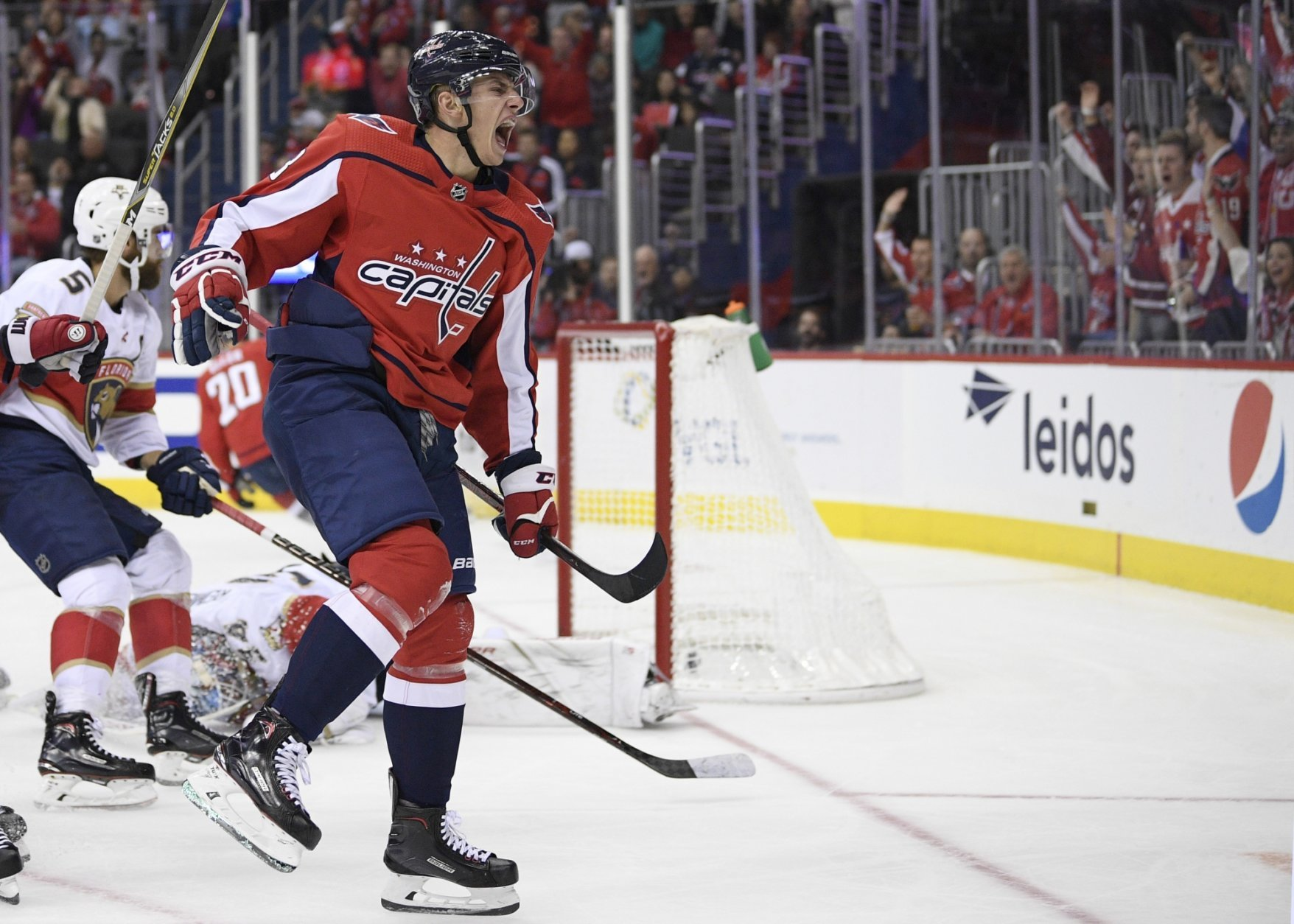 Washington Capitals left wing Jakub Vrana (13), of the Czech Republic, celebrates his goal during the second period of an NHL hockey game against the Florida Panthers, Friday, Oct. 19, 2018, in Washington. (AP Photo/Nick Wass)