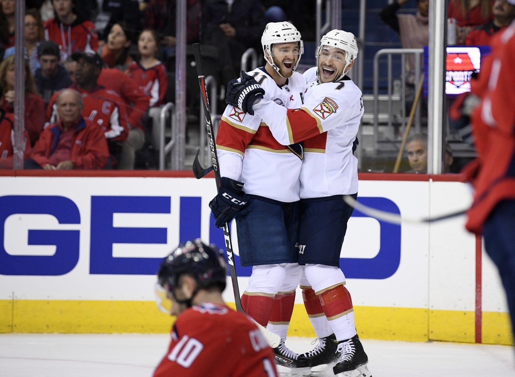 Florida Panthers center Colton Sceviour (7) celebrates his goal with left wing Jonathan Huberdeau (11) during the first period of an NHL hockey game as Washington Capitals right wing Brett Connolly (10) sits on the ice, Friday, Oct. 19, 2018, in Washington. (AP Photo/Nick Wass)
