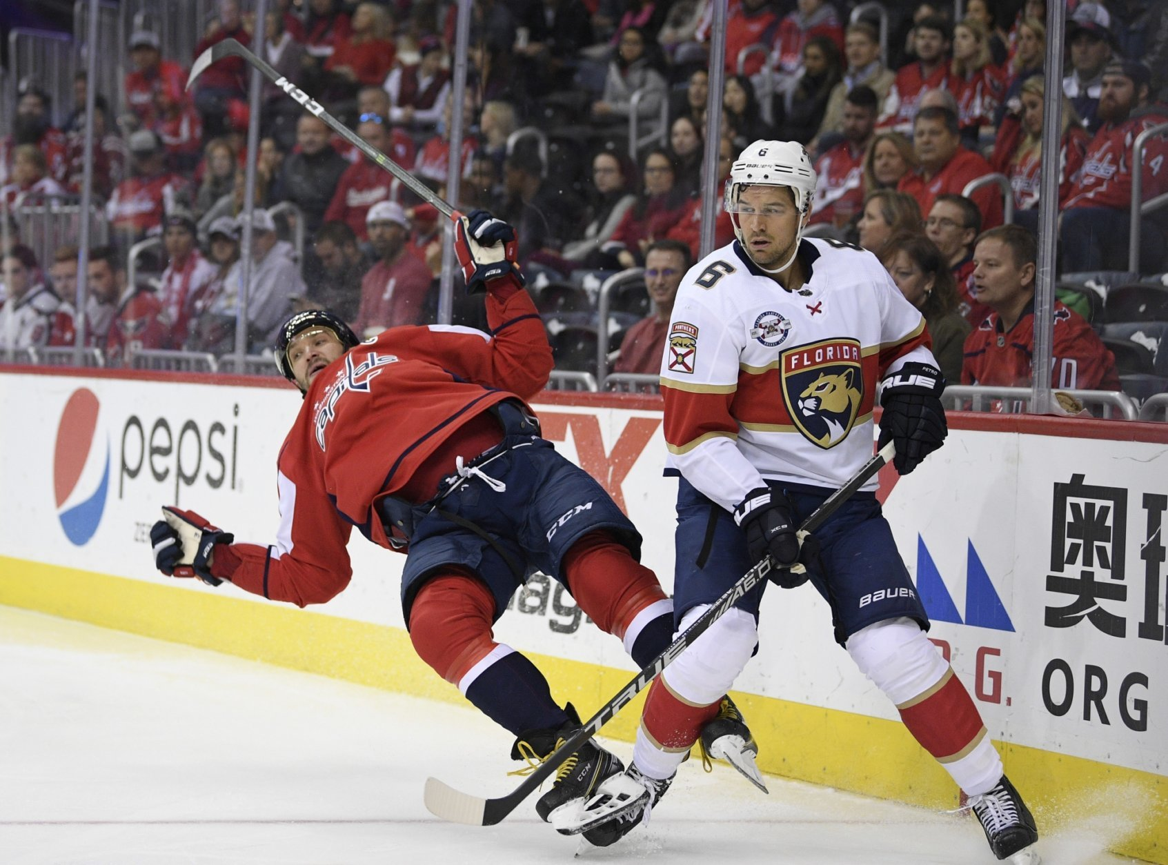 Washington Capitals left wing Alex Ovechkin, left, of Russia, collides with Florida Panthers defenseman Alexander Petrovic (6) during the second period of an NHL hockey game, Friday, Oct. 19, 2018, in Washington. (AP Photo/Nick Wass)