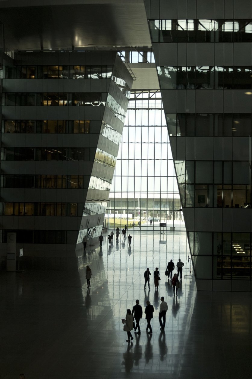 People walk through the main hall of NATO headquarters prior to a meeting of NATO defense ministers in Brussels, Wednesday, Oct. 3, 2018. (AP Photo/Francisco Seco)