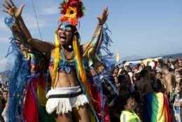 """A performer dances during the annual Gay Pride Parade along Copacabana beach in Rio de Janeiro, Brazil, Sunday, Sept. 30, 2018. One week before Brazil's presidential elections, organizers coined the theme of the parade """"Vote on ideas and not in people,"""" aiming to encourage people to vote for candidates who support gay and human rights. (AP Photo/Silvia Izquierdo)"""