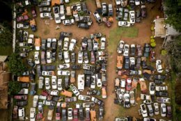 This aerial photo shows a car scrapyard in Lambare, Paraguay, Wednesday, Oct. 24, 2018. (AP Photo/Jorge Saenz)