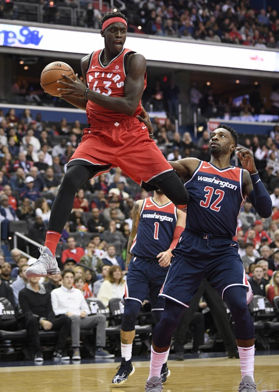 Toronto Raptors forward Pascal Siakam (43) leaps up with the ball against Washington Wizards forward Jeff Green (32) during the first half of an NBA basketball game, Saturday, Oct. 20, 2018, in Washington. (AP Photo/Nick Wass)