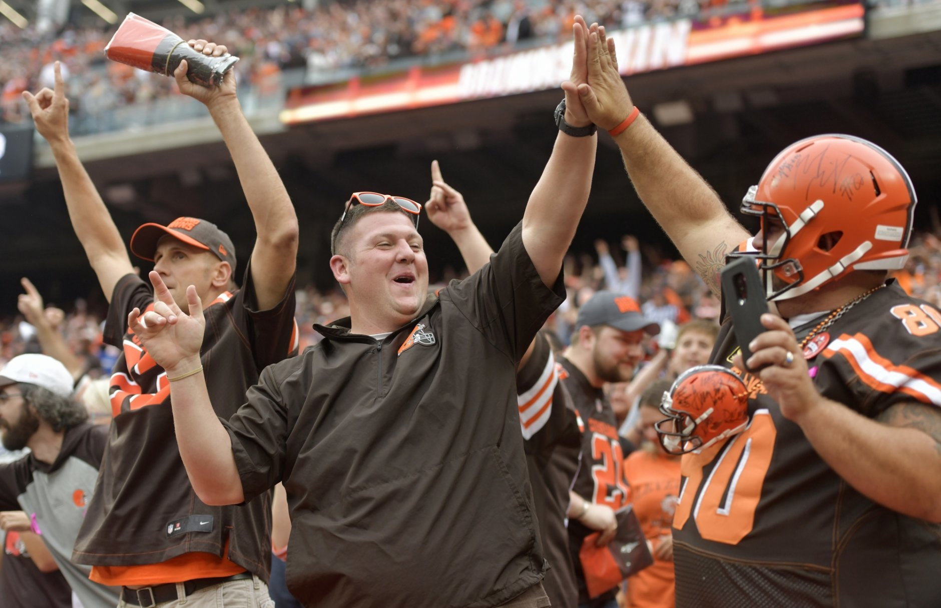 Cleveland Browns fans celebrate after the Browns defeated the Baltimore Ravens 12-9 during overtime in an NFL football game, Sunday, Oct. 7, 2018, in Cleveland. (AP Photo/David Richard)
