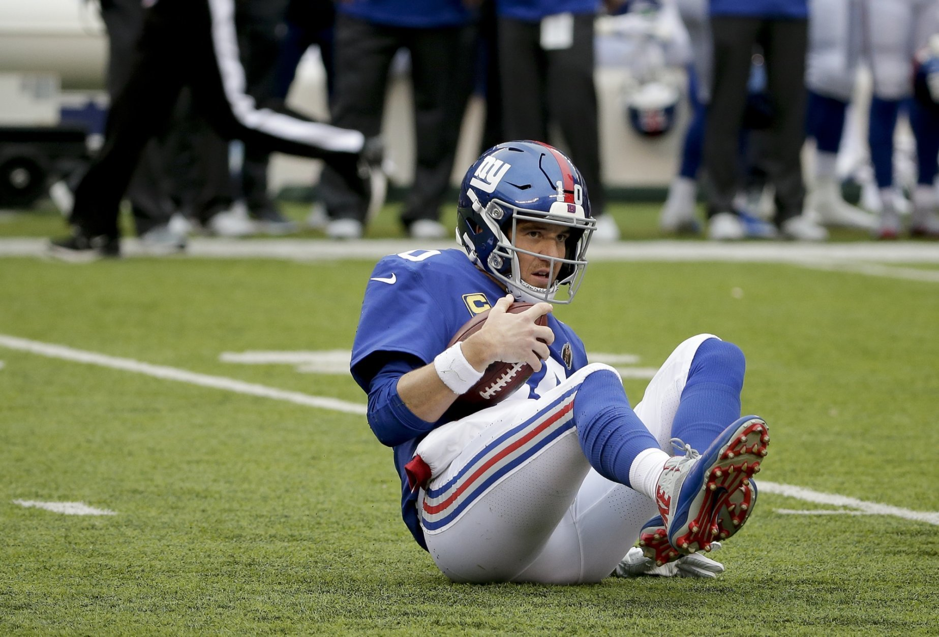 New York Giants quarterback Eli Manning (10) gets up off the turf after being sacked by the Washington Redskins during the second quarter of an NFL football game, Sunday, Oct. 28, 2018, in East Rutherford, N.J. (AP Photo/Seth Wenig)