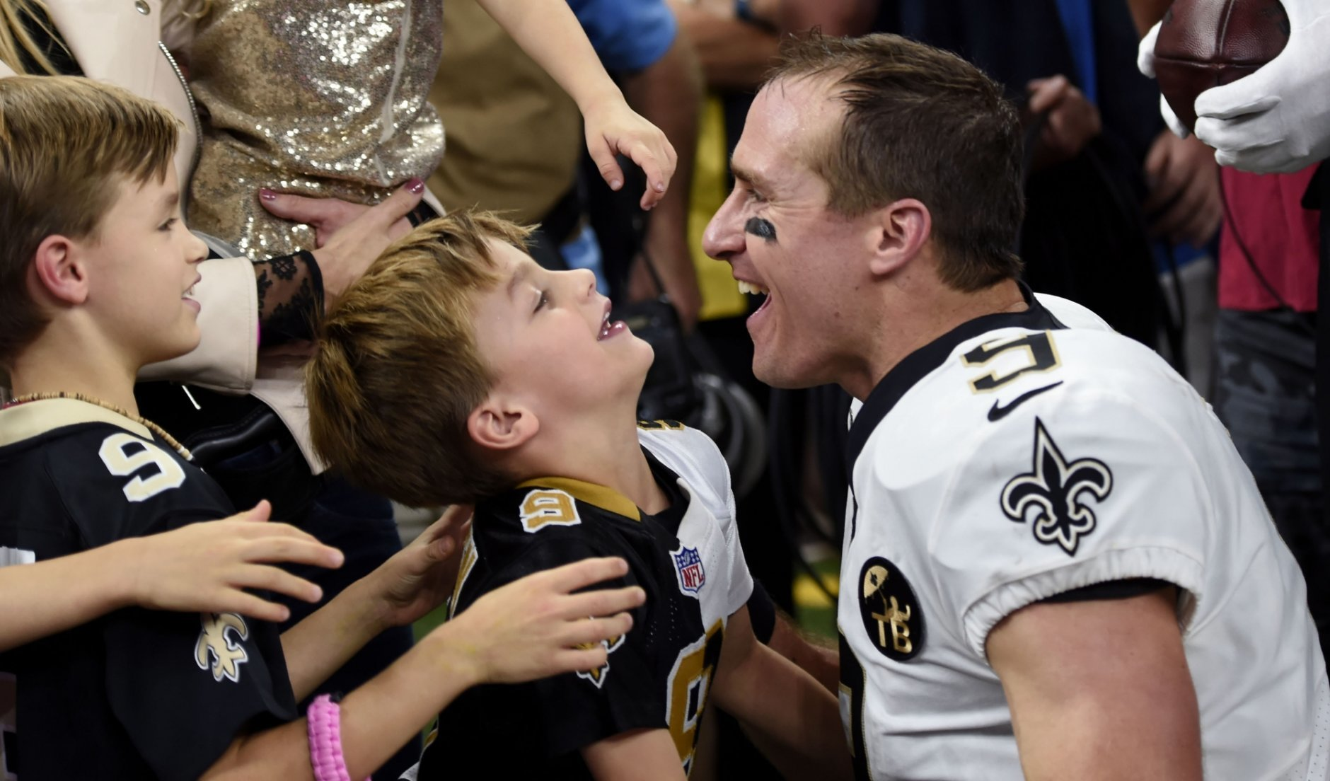 New Orleans Saints quarterback Drew Brees (9) greets his family after he broke the NFL all-time passing yards record in the first half of an NFL football game against the Washington Redskins in New Orleans, Monday, Oct. 8, 2018. (AP Photo/Bill Feig)