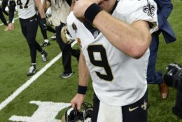 New Orleans Saints quarterback Drew Brees (9) wipes his eyes as he crosses the field after an NFL football game in New Orleans, Monday, Oct. 8, 2018. Brees broke the NFL all-time passing yards record during the game. The Saints won 43-19. (AP Photo/Bill Feig)