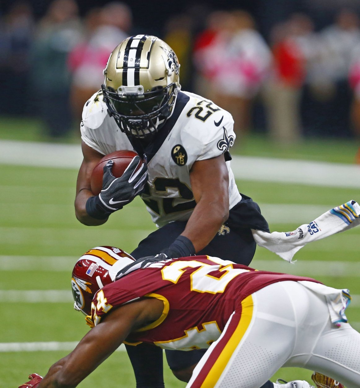 New Orleans Saints running back Mark Ingram (22) carries against Washington Redskins cornerback Josh Norman (24) in the first half of an NFL football game in New Orleans, Monday, Oct. 8, 2018. (AP Photo/Butch Dill)