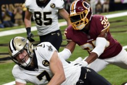 New Orleans Saints quarterback Taysom Hill (7) carries against Washington Redskins strong safety Montae Nicholson (35) in the first half of an NFL football game in New Orleans, Monday, Oct. 8, 2018. The Saints won 43-19. (AP Photo/Bill Feig)