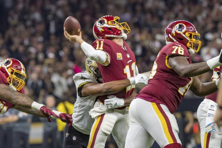 Marcus Davenport hits Redskins quarterback Alex Smith as the New Orleans  Saints during Monday Night Football at the Mercedes-Benz Superdome. 647674b21