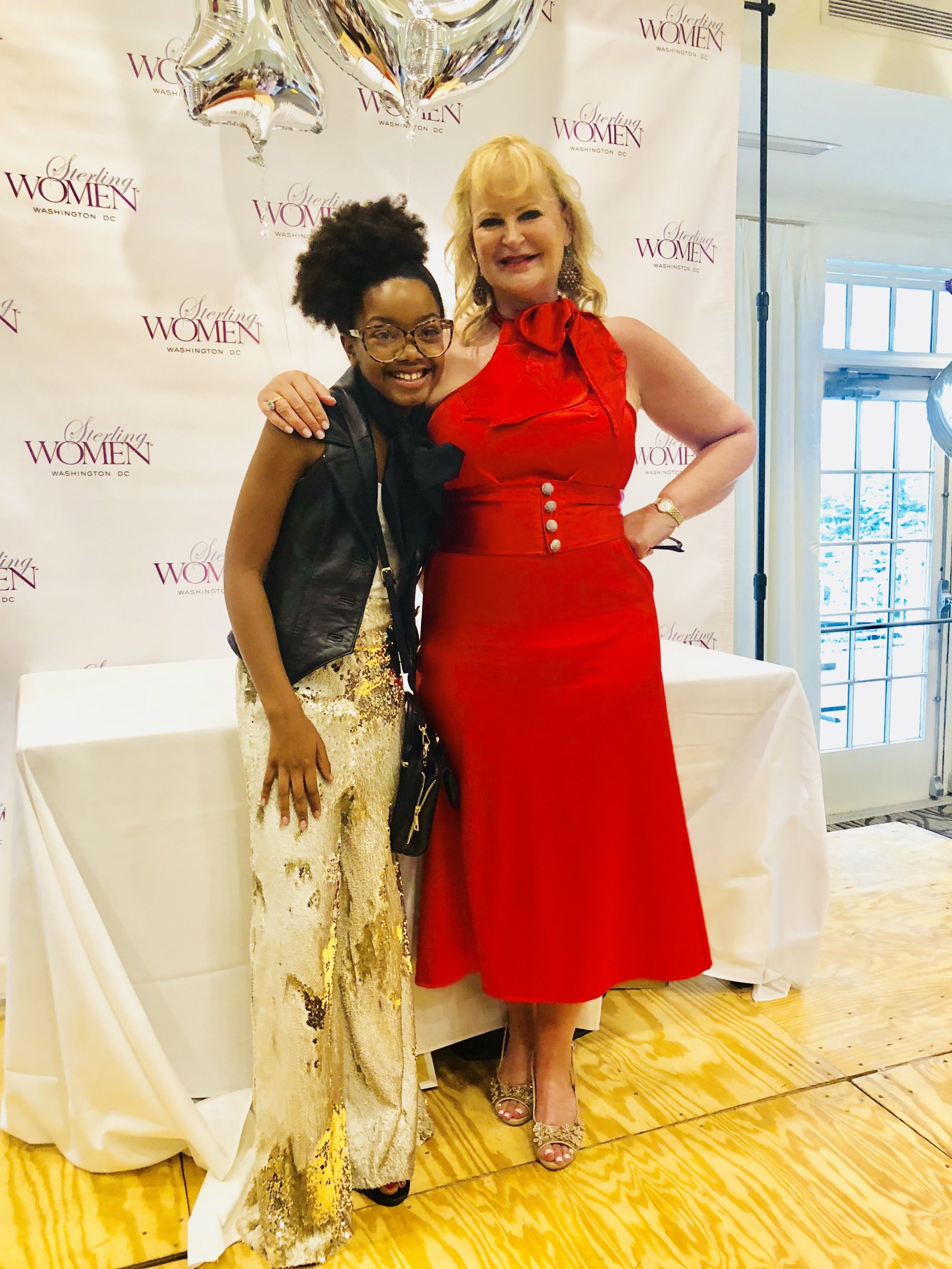 """Both these outfits are """"Sew Fly Sky"""" designs by Skylar Raiyn. Posing with Kristina Bouweiri, the owner of Reston Limousine, Sklyar created the dress for the Sterling Women 10th Anniversary Luncheon in August. (Courtesy, Danyel Trammell)"""