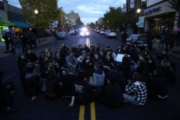 Protesters demonstrate on a main road in the Squirrel Hill neighborhood of Pittsburgh Tuesday, Oct. 30, 2018. Protests were held as President Donald Trump and first lady Melania Trump were visiting a memorial at the Tree of Life Synagogue in Pittsburgh, to honor the victims of a mass shooting at the synagogue on Saturday. (AP Photo/Matt Rourke)