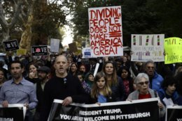 Protesters demonstrate near Pittsburgh's Tree of Life Synagogue where President Donald Trump and first lady Melania Trump were visiting a memorial in Pittsburgh, Tuesday, Oct. 30, 2018. The Trumps came to Pittsburgh to honor the victims of a mass shooting at the synagogue last week. (AP Photo/Matt Rourke)