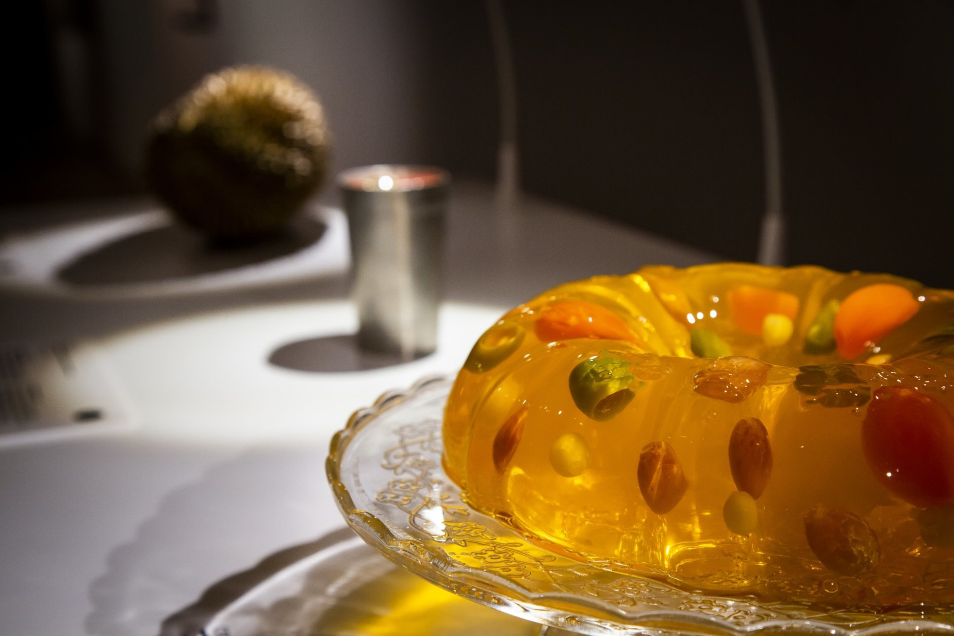 In this photo taken on Sept. 22, 2018 Jello-O-Salad on display at the Disgusting Food Museum, in Malmo,  Sweden. This comfort food is made with the candy-flavored gelatin Jell-O. Considered traditional American in the 1960s, it was especially popular amongst members of the Mormon Church. The various recipes include ingredients such as tomato soup, mayonnaise, cream cheese, vegetables, sausages, olives or anything else that may look good suspended in the colorful jelly. Dozen of foods likely to provoke extreme disgust in many people _ but considered palatable, even precious delicacies, in their home cultures _ go on display Wednesday, Oct. 31, 2018 as the Disgusting Food Museum makes its world premiere in Malmo, Sweden. (Anja Barte Telin via AP)