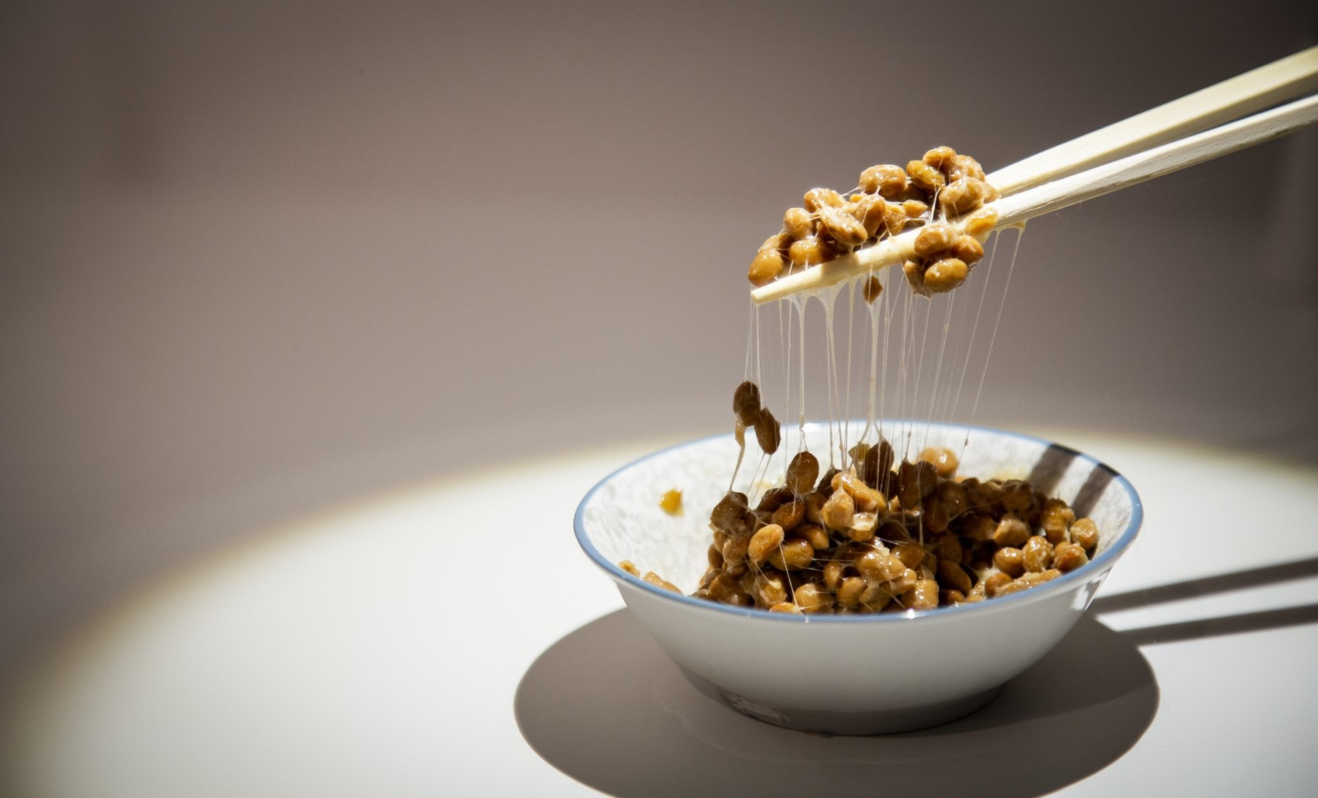 In this photo taken on Sept. 22, 2018 a bowl of Natto a traditional Japanese food made from soybeans fermented with Bacillus subtilis var, on display at the Disgusting Food Museum, in Malmo, Sweden. Dozen of foods likely to provoke extreme disgust in many people _ but considered palatable, even precious delicacies, in their home cultures _ go on display Wednesday, Oct. 31, 2018 as the Disgusting Food Museum makes its world premiere in Malmo, Sweden. (Anja Barte Telin via AP)