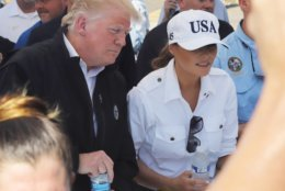 President Donald J Trump and first lady Melania Trump hand out water at a relief station in Lynn Haven, Florida during a visit on Monday, Oct. 15, 2018 to see the storm damage and recovery efforts following Hurricane Michael. (Michael Snyder/Northwest Florida Daily News via AP)