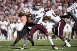 Texas A&M quarterback Kellen Mond (11) attempts a pass during the first half of an NCAA college football game against South Carolina Saturday, Oct. 13, 2018, in Columbia, S.C. (AP Photo/Sean Rayford)