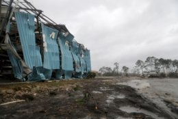 A marina warehouse is damaged at the Port St. Joe Marina, Wednesday, Oct. 10, 2018 in Port St. Joe, Fla. Supercharged by abnormally warm waters in the Gulf of Mexico, Hurricane Michael slammed into the Florida Panhandle with terrifying winds of 155 mph Wednesday, splintering homes and submerging neighborhoods. (Douglas R. Clifford/Tampa Bay Times via AP)