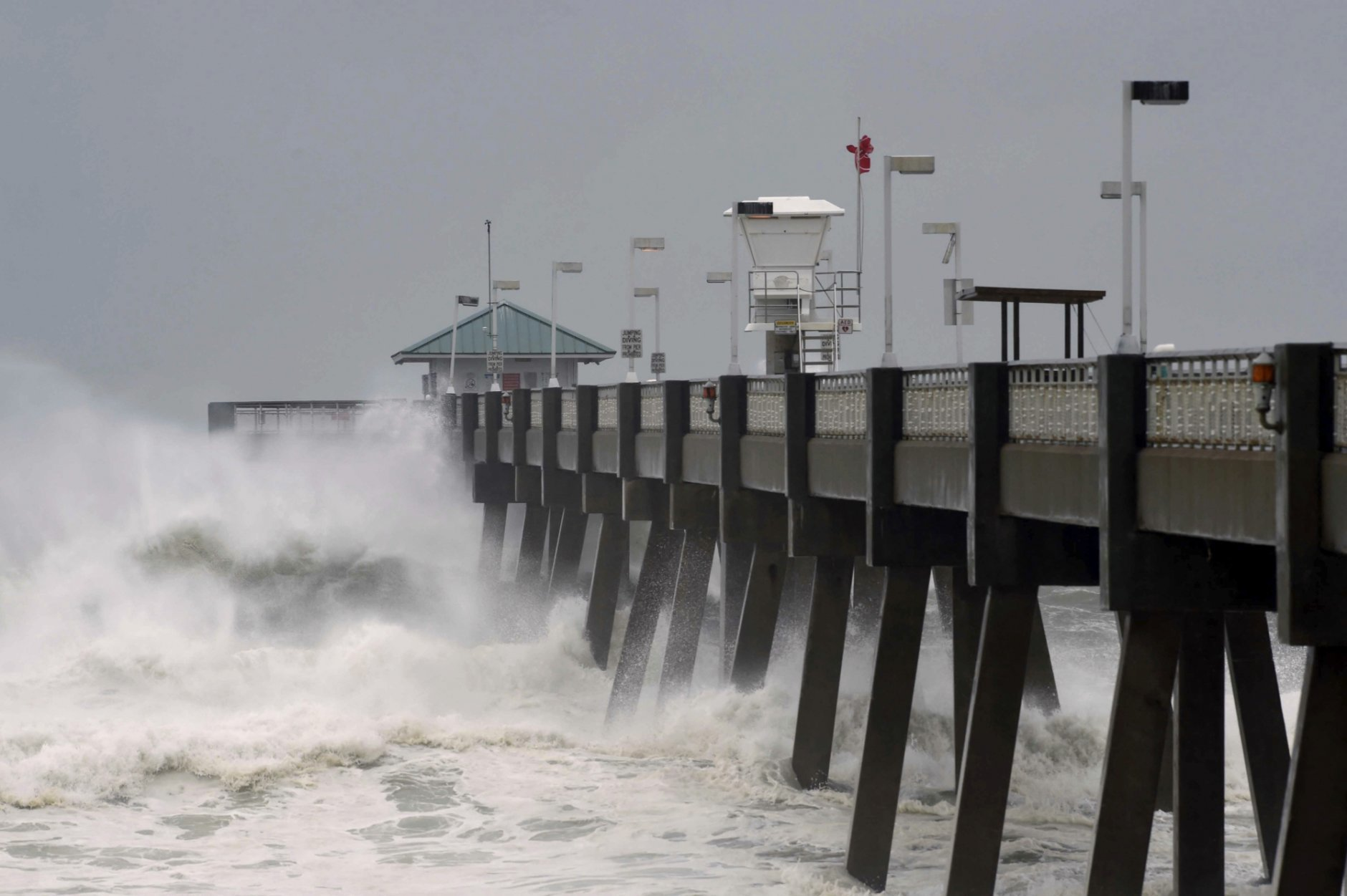 Heavy surf from the approaching Hurricane Michael pounds the fishing pier on Okaloosa Island in Fort Walton Beach, Fla., on Wednesday, Oct. 10, 2018. (Devon Ravine/Northwest Florida Daily News via AP)