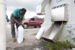 Willie Sanders bags ice for himself and his family in Panama City, Florida as Hurricane Michael approaches on Tuesday, October 9, 2018. He and his family are not evacuating as they do not live in a mandatory evacuation area. (Joshua Boucher/News Herald via AP)