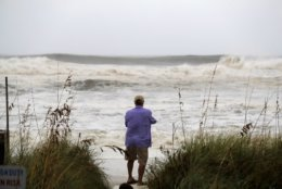 People photograph the surf from encroaching Hurricane Michael, which is expected to make landfall today, in Panama City Beach, Fla., Wednesday, Oct. 10, 2018.   The hurricane center says Michael will be the first Category 4 hurricane to make landfall on the Florida Panhandle. (AP Photo/Gerald Herbert)