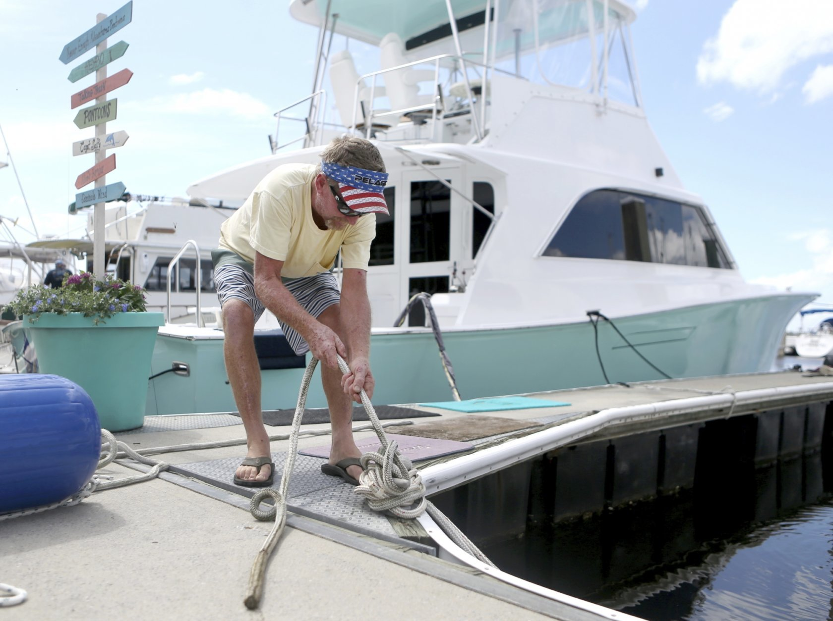Rob Docko ties a knot while securing his boat at the St. Andrews Marina in Panama City, Fla., Monday, Oct. 8, 2018, to prepare for Hurricane Michael. (Patti Blake /News Herald via AP)