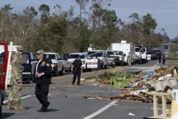 Tampa Bay Times Emergency workers form a caravan at the western edge of town at Mexico Beach, population 1200, where they planned to join the South Florida Search and Rescue Task Force to clear home and to make contact with survivors in the township which lay devastated on Thursday, Oct 11, 2018, after Hurricane Michael made landfall on Wednesday in the Florida Panhandle. Brock said he stayed in the city to ride out the storm. (Douglas R. Clifford/Tampa Bay Times via AP)