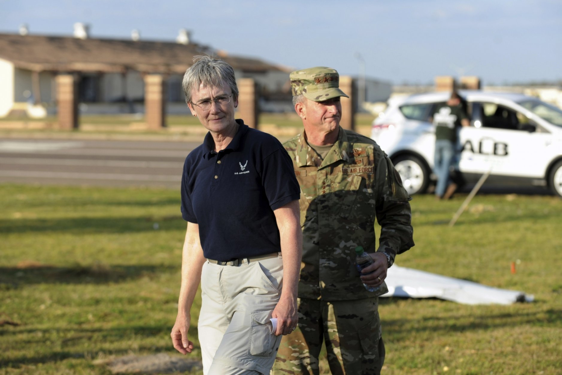 In this Sunday, Oct. 14, 2018, photo, Secretary of the U.S. Air Force Heather Wilson and U.S. Air Force Chief of Staff David Goldfein walk to a briefing at Tyndall Air Force Base in Florida to speak to reporters about the status of the base, which suffered significant damage from Hurricane Michael. (Carlos R. Munoz/Sarasota Herald-Tribune via AP)