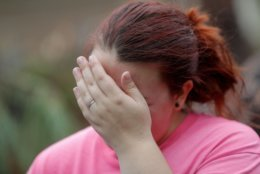 Kaylee O'Brian cries as she's unable to find her cat after several trees fell on her now-destroyed home during Hurricane Michael in Panama City, Fla., Wednesday, Oct. 10, 2018. (AP Photo/Gerald Herbert)