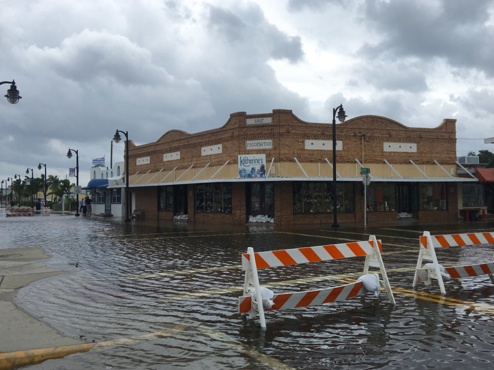 High tide from offshore Hurricane Michael creeps up into the Sponge Docks in Tarpon Springs, Fla., Wednesday, Oct. 10, 2018 after the Anclote River backs up. (Jim Damaske/The Tampa Bay Times via AP)