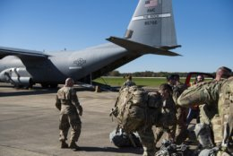 This Oct. 29, 2018 photo provided by the U.S. Air Force shows deployers from Headquarters Company, 89th Military Police Brigade, Task Force Griffin get ready to board a C-130J Super Hercules from Little Rock, Arkansas, at Fort Knox, Kentucky, in support of Operation Faithful Patriot. The Trump administration on Monday, Oct. 29, 2018, announced plans to deploy 5,200 active duty troops, double the 2,000 who are in Syria fighting the Islamic State group, to the border to help stave off the caravans. The main caravan, still in southern Mexico, was continuing to melt away, from the original 7,000 to about 4,000, as a smaller group apparently hoped to join it. (Airman 1st Class Zoe M. Wockenfuss/U.S. Air Force via AP)