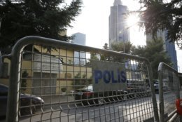 """Barriers block the road leading to Saudi Arabia's consulate, background, in Istanbul, Saturday, Oct. 20, 2018. Turkey will """"never allow a cover-up"""" of the killing of Saudi journalist Jamal Khashoggi in Saudi Arabia's consulate in Istanbul, a senior official in Turkey's ruling party said Saturday after Saudi Arabia announced hours earlier that the writer died during a """"fistfight"""" in its consulate. (AP Photo/Lefteris Pitarakis)"""