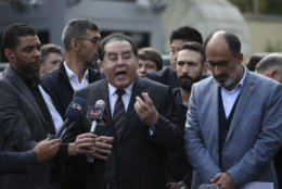 """Ayman Nour, an Egyptian dissident, second left, and Turan Kislakci, right, head of the Turkish-Arab media association talk to the media regarding Saudi journalist Jamal Khashoggi, near Saudi Arabia's consulate in Istanbul, Saturday, Oct. 20, 2018. Turkey will """"never allow a cover-up"""" of the killing of Saudi journalist Jamal Khashoggi in Saudi Arabia's consulate in Istanbul, a senior official in Turkey's ruling party said Saturday after Saudi Arabia announced hours earlier that the writer died during a """"fistfight"""" in its consulate. (AP Photo/Emrah Gurel)"""