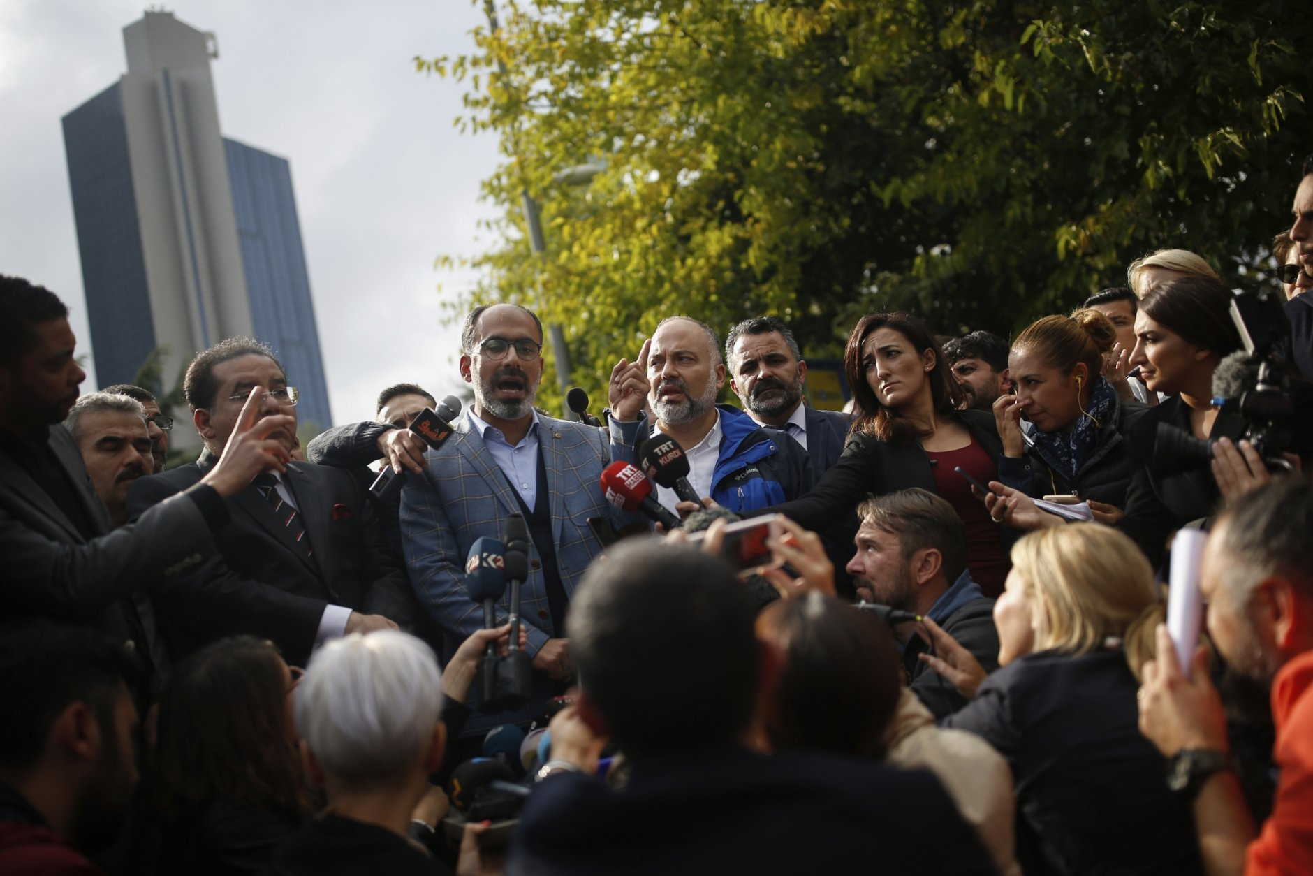 """Turan Kislakci, head of the Turkish-Arab media association and friend of Saudi journalist Jamal Khashoggi talks to the media, near Saudi Arabia's consulate in Istanbul, Saturday, Oct. 20, 2018. Turkey will """"never allow a cover-up"""" of the killing of Saudi journalist Jamal Khashoggi in Saudi Arabia's consulate in Istanbul, a senior official in Turkey's ruling party said Saturday after Saudi Arabia announced hours earlier that the writer died during a """"fistfight"""" in its consulate. (AP Photo/Emrah Gurel)"""