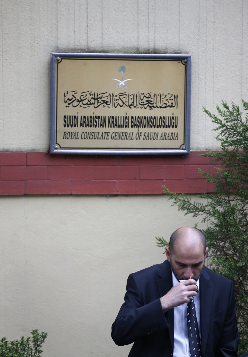 """A security sips teas outside Saudi Arabia's consulate in Istanbul, Saturday, Oct. 20, 2018. Saudi Arabia claims Saudi journalist Jamal Khashoggi died in a """"fistfight"""" in consulate, finally admitting that the writer had been slain at its diplomatic post. The overnight announcements in Saudi state media came more than two weeks after Khashoggi, 59, entered the building for paperwork required to marry his Turkish fiancée, and never came out.(AP Photo/Lefteris Pitarakis)"""