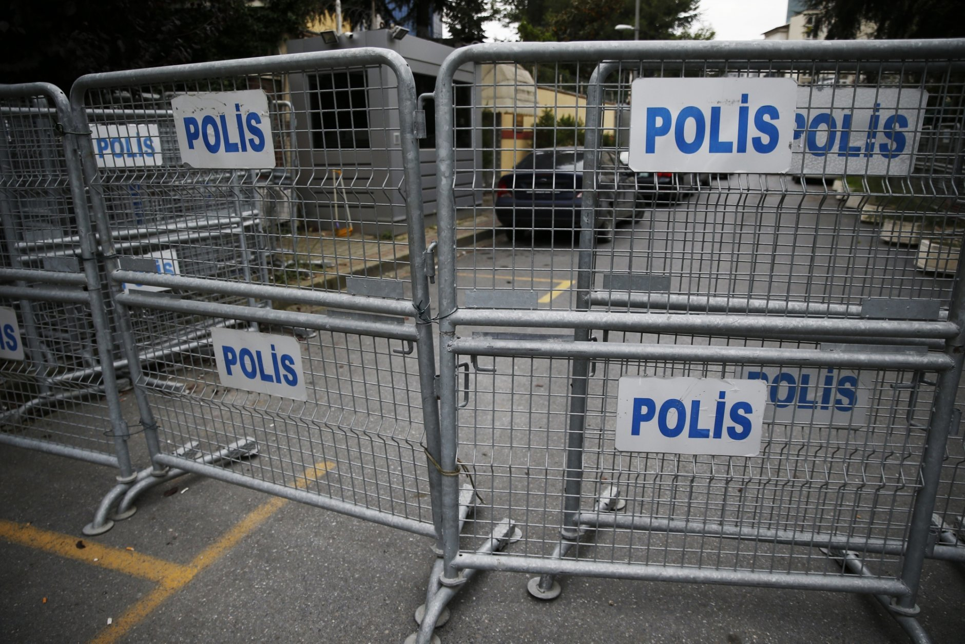 """Barriers block the road leading to Saudi Arabia's consulate in Istanbul, Saturday, Oct. 20, 2018. Saudi Arabia claims Saudi journalist Jamal Khashoggi died in a """"fistfight"""" in consulate, finally admitting that the writer had been slain at its diplomatic post. The overnight announcements in Saudi state media came more than two weeks after Khashoggi, 59, entered the building for paperwork required to marry his Turkish fiancée, and never came out.(AP Photo/Lefteris Pitarakis)"""