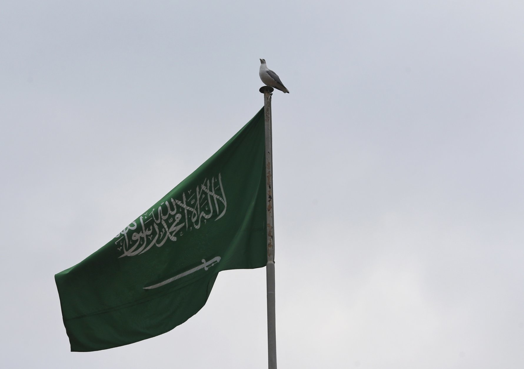"""The Saudi Arabia's flag flies atop the country's in Istanbul, Saturday, Oct. 20, 2018. Saudi Arabia claims Saudi journalist Jamal Khashoggi died in a """"fistfight"""" in consulate, finally admitting that the writer had been slain at its diplomatic post. The overnight announcements in Saudi state media came more than two weeks after Khashoggi, 59, entered the building for paperwork required to marry his Turkish fiancée, and never came out.(AP Photo/Lefteris Pitarakis)"""