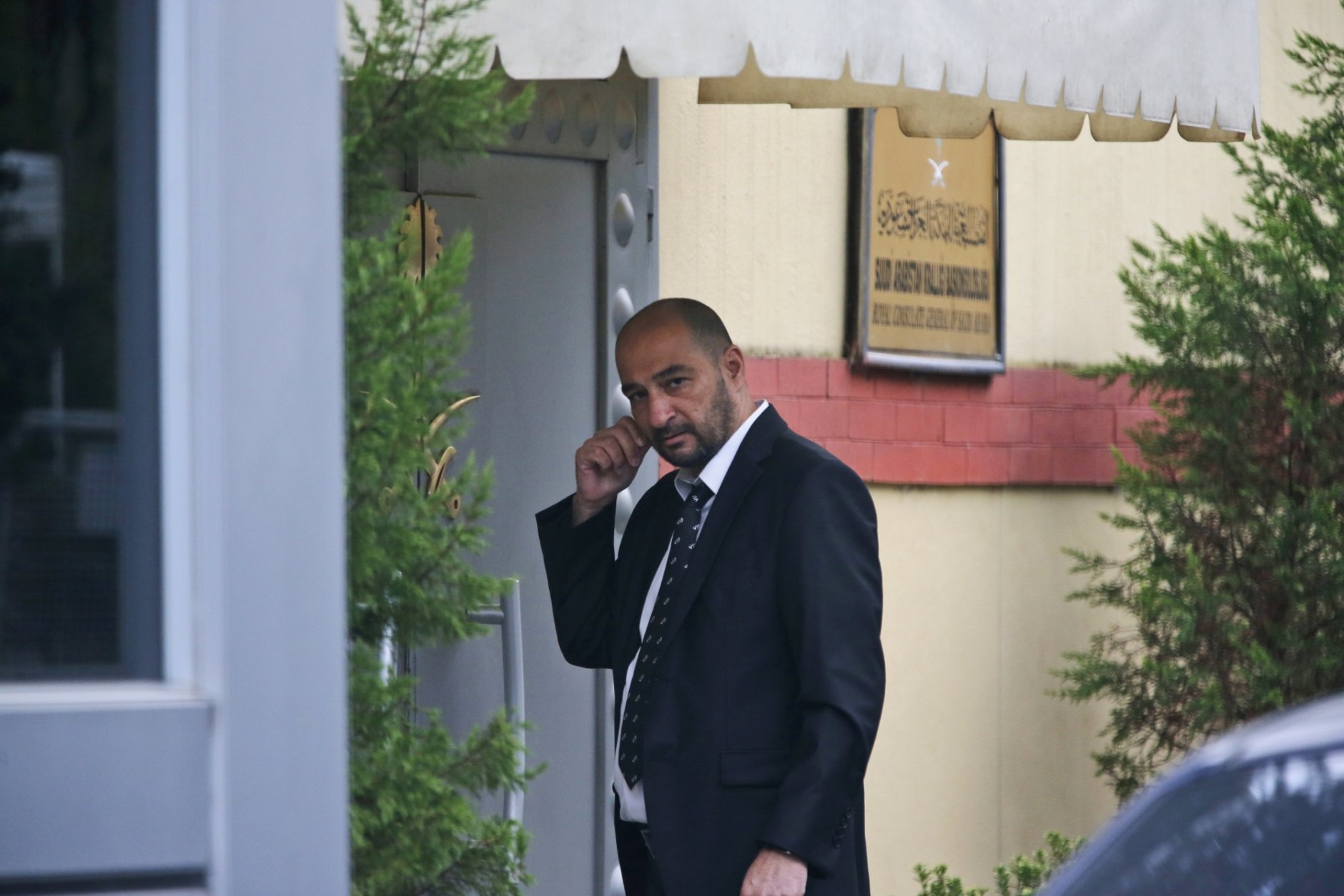"""A security guard walks outside Saudi Arabia's consulate in Istanbul, Saturday, Oct. 20, 2018. Saudi Arabia claims Saudi journalist Jamal Khashoggi died in a """"fistfight"""" in consulate, finally admitting that the writer had been slain at its diplomatic post. The overnight announcements in Saudi state media came more than two weeks after Khashoggi, 59, entered the building for paperwork required to marry his Turkish fiancée, and never came out.(AP Photo/Lefteris Pitarakis)"""