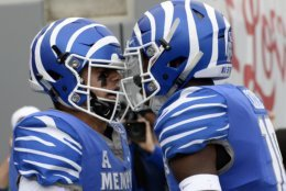 Memphis quarterback Brady White, left, celebrates with wide receiver Damonte Coxie (10) after Brady scored a touchdown on a 11-yard run against Central Florida during the first half of an NCAA college football game Saturday, Oct. 13, 2018, in Memphis, Tenn. (AP Photo/Mark Zaleski)