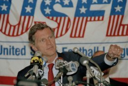 United States Football League commissioner Harry Usher gestures during a news conference in New York, Aug. 4, 1986. the USFL club owners voted to suspend play until 1987, less than a week after they were awarded only $3 in damages in a $1.69 billion anti-trust suit against the National Football League. The eight-team league, which operated for three years with a spring-summer schedule, was to have opened its first fall schedule on Sept. 13. (AP Photo/Susan Ragan)