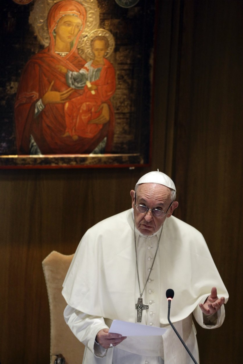 Pope Francis speaks during the opening of the15th Ordinary General Assembly of the Synod of Bishops, at the Vatican, Wednesday, Oct. 3, 2018. The Oct. 3-28 synod is opening under a fresh cloud of scandal with new revelations about decades of sexual misconduct and cover-up in the U.S., Chile, Germany and elsewhere. (AP Photo/Gregorio Borgia)